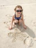Чертеж девушки в песке Стоковое фото RF