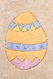 Чертеж пасхального яйца в песке Стоковые Изображения