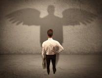 Честный продавец с концепцией тени ангела Стоковое Фото