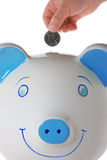 четверть s руки ребенка банка падая piggy Стоковое Фото