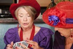 чешет повелительницы шлемов играя красный носить Стоковое Изображение RF