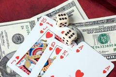чешет покер долларов стоковое фото
