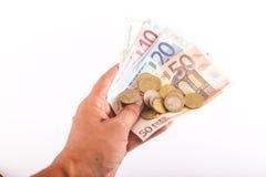 Человек дает деньги евро Стоковая Фотография