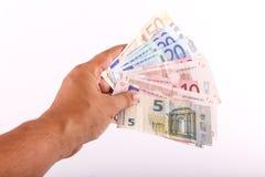 Человек дает деньги евро Стоковое Фото