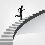 Человек бежать вверх на винтовой лестнице Стоковое Фото
