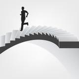 Человек бежать вниз на винтовой лестнице Стоковая Фотография