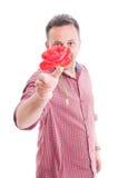 Человек бросая цветок к камере стоковое фото rf