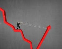 Человек вытягивая вверх по идти вниз с красной стрелки Стоковые Изображения RF