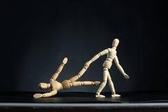 Человек вытягивая женщину ногой Стоковые Фотографии RF
