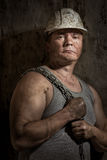Человек в горнорабочей шлема Стоковое фото RF