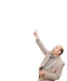 Человек в деловом костюме показывает его указательный палец вверх, рисующ attentio Стоковые Изображения RF