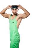 Человек в зеленых coveralls стоковые фото