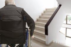 Человек в инвалидной коляске Стоковые Фотографии RF