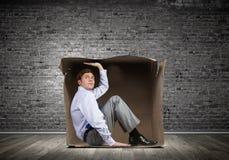 Человек в коробке Стоковые Изображения RF