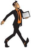 Человек в костюме нося таблетку графиков стоковое фото rf