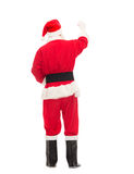 Человек в костюме сочинительства Санта Клауса что-то Стоковое Изображение