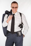 Человек в костюме с оружием Стоковое фото RF
