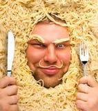 Человек в макаронных изделиях Стоковые Фото