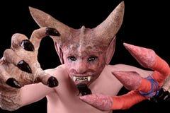 Человек в маске дьявола Стоковое фото RF