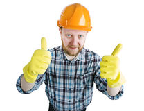 Человек в оранжевом шлеме и перчатках конструкции стоковые изображения