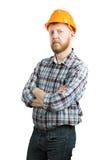 Человек в оранжевом шлеме конструкции стоковые изображения rf