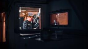 Человек в рубке корабля сток-видео