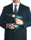 Человек в сверле удерживания сюиты Стоковые Фотографии RF