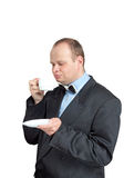 Человек в чае костюма выпивая стоковая фотография rf