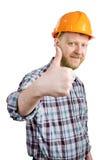 Человек в шлеме показывает что все ОДОБРЕНО стоковые фото