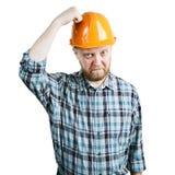 Человек грохает его руку на защитном шлеме стоковое изображение rf