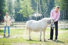 Человек, девушка и лошадь Стоковые Фотографии RF