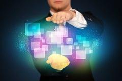 Человек держа абстрактные значки Стоковое Изображение