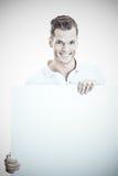 Человек держа большую белую доску Стоковые Изображения RF