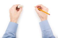 Человек держа карандаш и истиратель стоковое фото rf