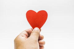 Человек держа красную форму сердца в его руках Стоковое фото RF
