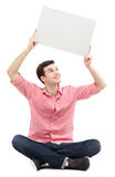 Человек держа пустой плакат Стоковая Фотография