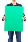 Человек держа пустую зеленую доску Стоковая Фотография RF
