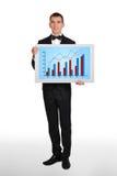 Человек держа плазму с диаграммой Стоковое Фото