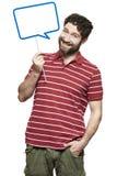Человек держа усмехаться знака пузыря речи Стоковое фото RF