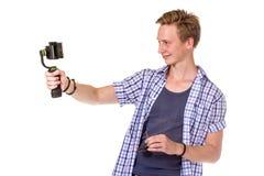 Человек держит малую камеру действия Стоковая Фотография