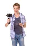 Человек держит малую камеру действия Стоковое Изображение RF