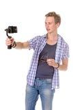 Человек держит малую камеру действия Стоковое Изображение