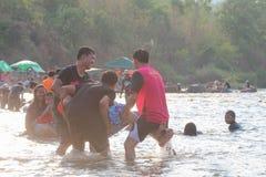 Человек играя воду Стоковые Изображения RF