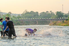 Человек играя воду Стоковая Фотография RF