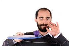 Человек играя ракетки стоковое изображение
