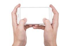 Человек используя современный умный телефон изолированный на белизне стоковая фотография