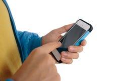 Человек используя умный телефон изолированный на белой предпосылке Стоковое фото RF