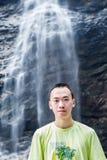 Человек и водопад Стоковая Фотография