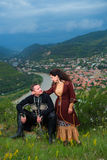Человек и женщина в грузинском национальном платье Стоковое Изображение