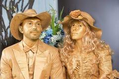 Человек и женщина в золотом цвете Стоковое фото RF